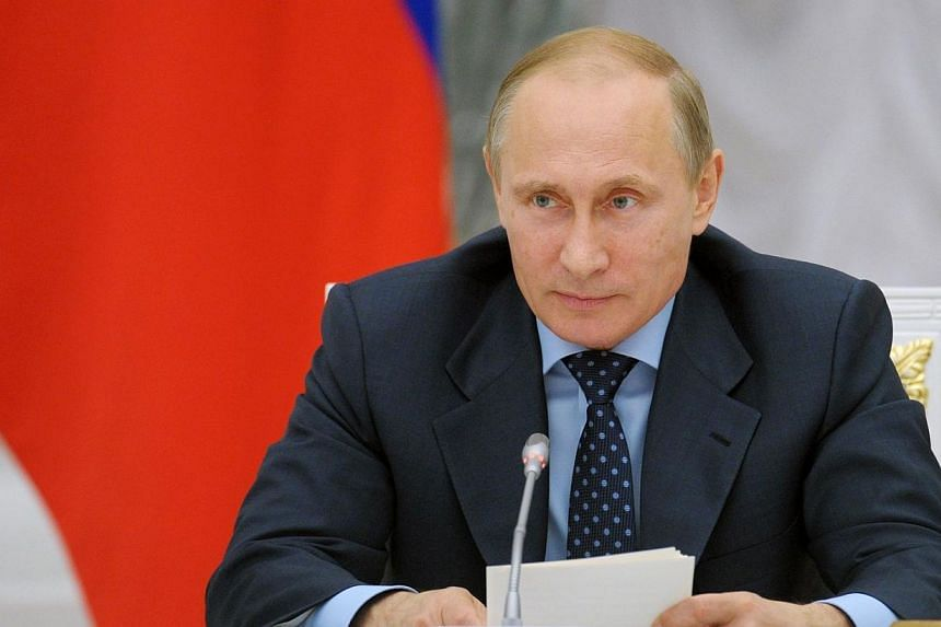 Russian President Vladimir Putin attends a meeting of the Presidential Council For Science and Education at the Kremlin in Moscow on June 23, 2014.Mr Putin on Tuesday, June 24, 2014, asked the upper chamber of parliament to cancel a resolution