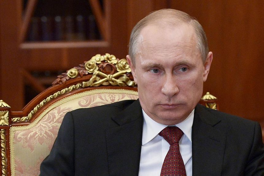 Russia's President Vladimir Putin attends a meeting in the Kremlin in Moscow on June 20, 2014. Mr Putin on Tuesday, June 24, 2014, asked the upper house of parliament to revoke a resolution allowing him to send troops into Ukraine, a Kremlin spo