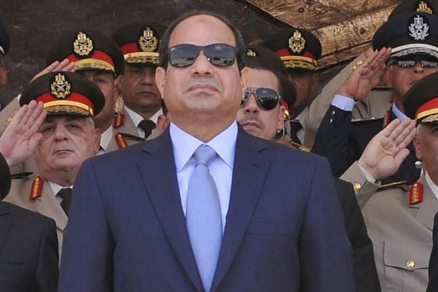 Egyptian President Abdel Fattah al-Sisi (centre) attends the graduation ceremony of the Air Force Academy in Cairo, in this June 22, 2014 picture provided by the Egyptian Presidency.Newly elected Egyptian President Abdel Fattah al-Sisi said on