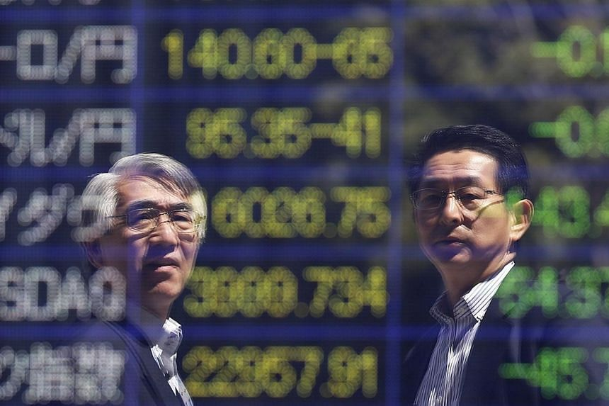 Stock market punters continued to stick to the sidelines on Tuesday, June 24, 2014, with shares little moved for a second day and trading volume remaining thin. -- PHOTO: REUTERS
