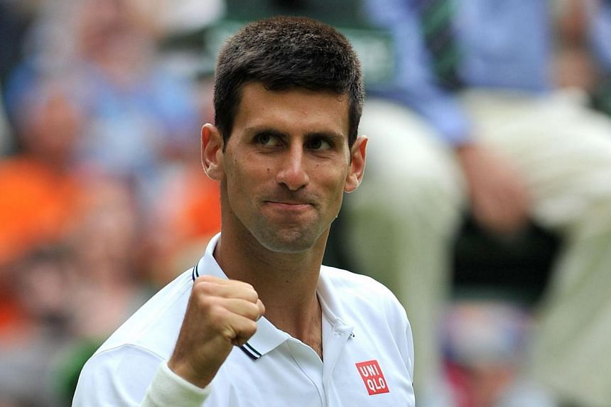 Serbia's Novak Djokovic celebrates winning his men's singles first round match against Kazakhstan's Andrey Golubev on day one of the 2014 Wimbledon Championships at The All England Tennis Club in Wimbledon, southwest London, on June 23, 2014. -- PHOT