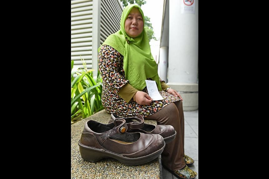 Ms Nur Najwa Abdullah and the $279 pair of shoes she bought last year. She said she wore them for six months before finding out – by chance – that the lining was made of pig skin. -- ST PHOTO: SEAH KWANG PENG