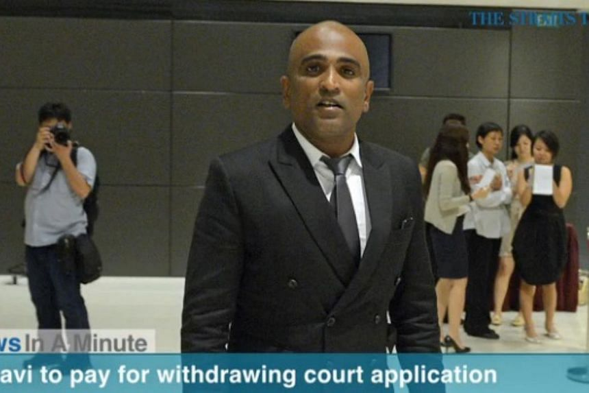 Lawyer M Ravi has been ordered to pay $1,000 for the cost of an application he made to drop charges against his five clients.-- PHOTO: SCREENGRAB FROM VIDEO