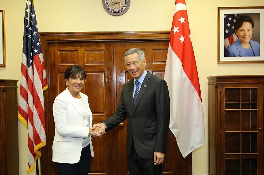 Prime Minister Lee Hsien Loong with United States Secretary of Commerce Penny Pritzkeron June 22, 2014. -- PHOTO: MCI