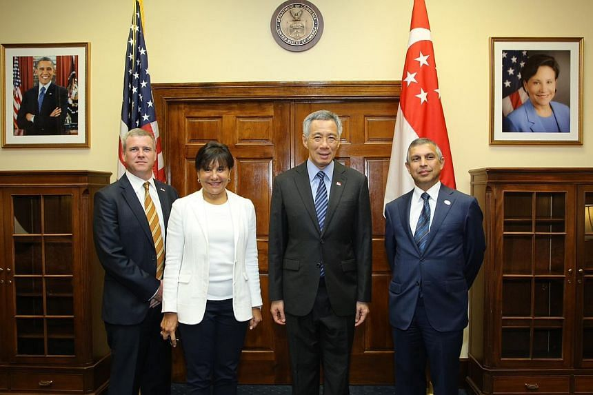 (From left) MrKirk Wagar,US ambassador to Singapore, United States Secretary of Commerce Penny Pritzker,Prime Minister Lee Hsien Loong and Ambassador Ashok Mirpuri, Ambassador of Republic of Singapore to USon June 22, 2014. --