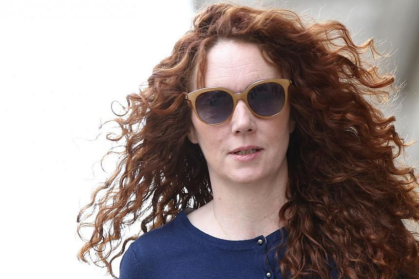 Former News International executive Rebekah Brooks arrives at the Old Bailey courthouse in London on June 20, 2014. Rebekah Brooks, who was cleared of all charges on Tuesday after the landmark phone-hacking trial, combined magnetic personal char