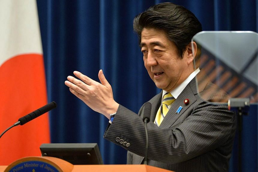 Japanese Prime Minister Shinzo Abe speaks during a press conference at his official residence in Tokyo on June 24, 2014, following the end of an ordinary Diet session. Philippine President Benigno Aquino, whose country was brutally invaded by Ja