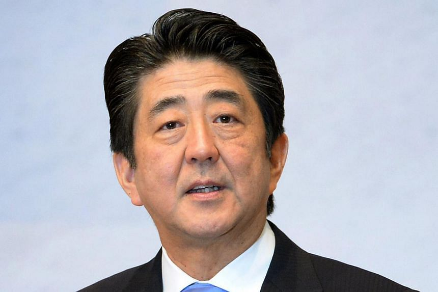Japanese Prime Minister Shinzo Abe delivers a speech at the Japan Business Federation general assembly in Tokyo on June 3, 2014. -- PHOTO: AFP