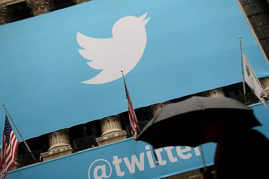 """A file picture taken on Nov 7, 2013 shows a banner with the logo of Twitter on the front of the New York Stock Exchange (NYSE) in New York.Russia asked Twitter on Monday to block access to a dozen accounts it deems """"extremist"""", the head of the"""
