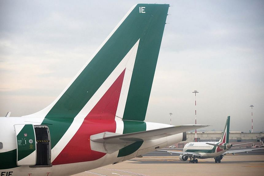 Abu Dhabi's state-owned Etihad Airways said on Wednesday, June 25, 2014, it had agreed principal terms and conditions to buy a 49 per cent stake in Italy's loss-making airline Alitalia. -- PHOTO: AFP