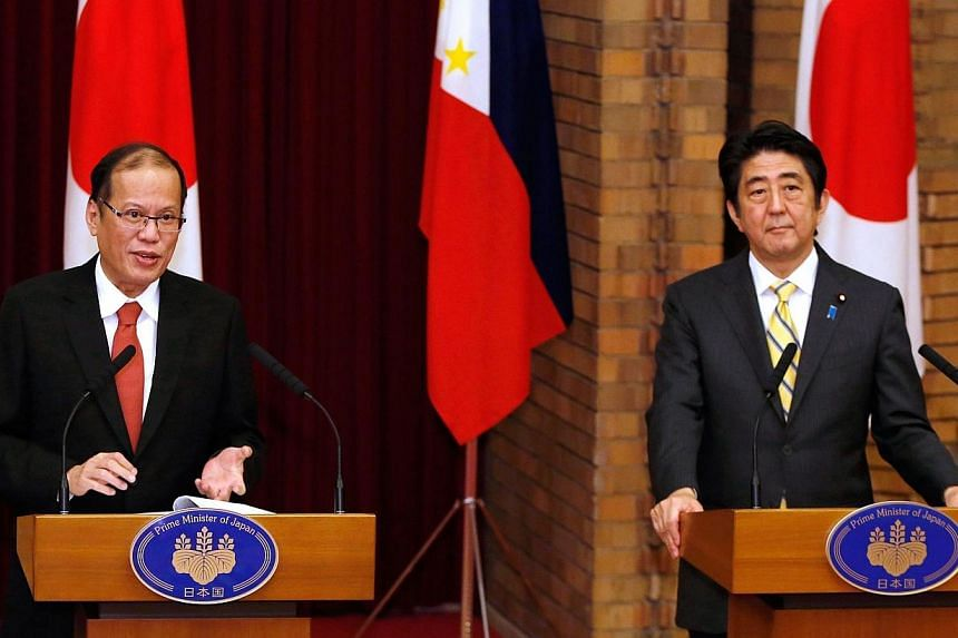 Philippines President Benigno Aquino (left) speaks as Japan's Prime Minister Shinzo Abe (right) listens during a joint news conference at the prime minister's official residence in Tokyo on June 24, 2014.China on Wednesday, June 25, 2014, accus