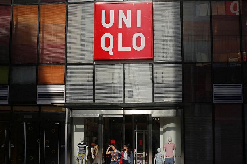 Customers walk out of a Uniqlo store at Taikoo Li Sanlitun shopping centre in Beijing on May 12, 2014.-- PHOTO: REUTERS