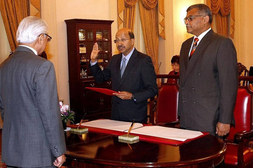 President Tony Tan Keng Yam (right) presides the swearing-in ceremony of Justice V K Rajah (centre) as Attorney-General and member of the Presidential Council for Minority Rights, as Chief Justice Sundaresh Menon looks on. -- ST PHOTO: CHEW SENG KIM