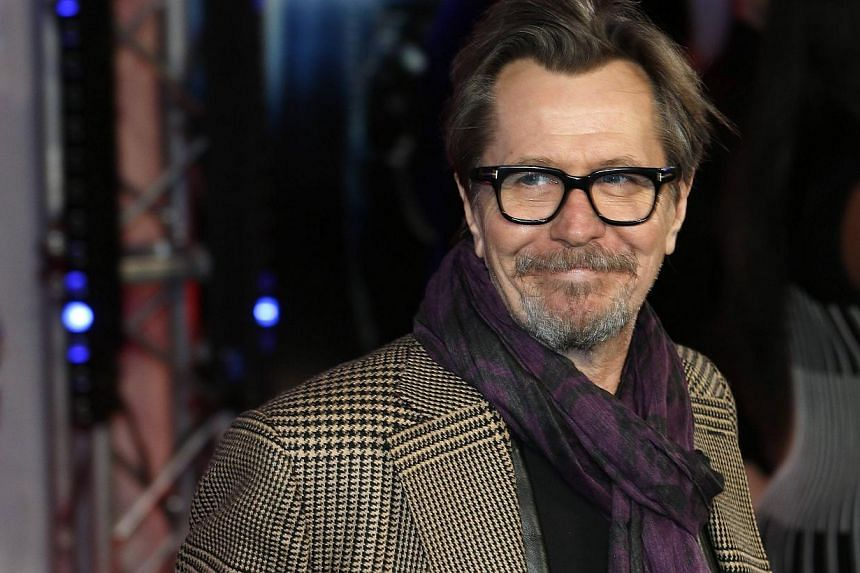 Gary Oldman poses for photographers in this Feb 5, 2014, file photo. Oldman's manager said on June 24, 2014 that the British actor was not defending Mel Gibson or Alec Baldwin in an interview about past comments they made about Jews and homosexuals,