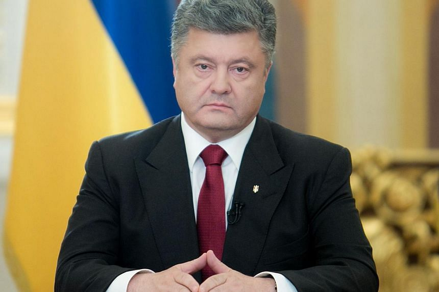 Ukraine's new Western-backed president said on Tuesday he may revoke his one-week unilateral ceasefire to allow government forces to retaliate for the downing by pro-Russian rebels of an army helicopter that killed nine servicemen. -- PHOTO: AFP