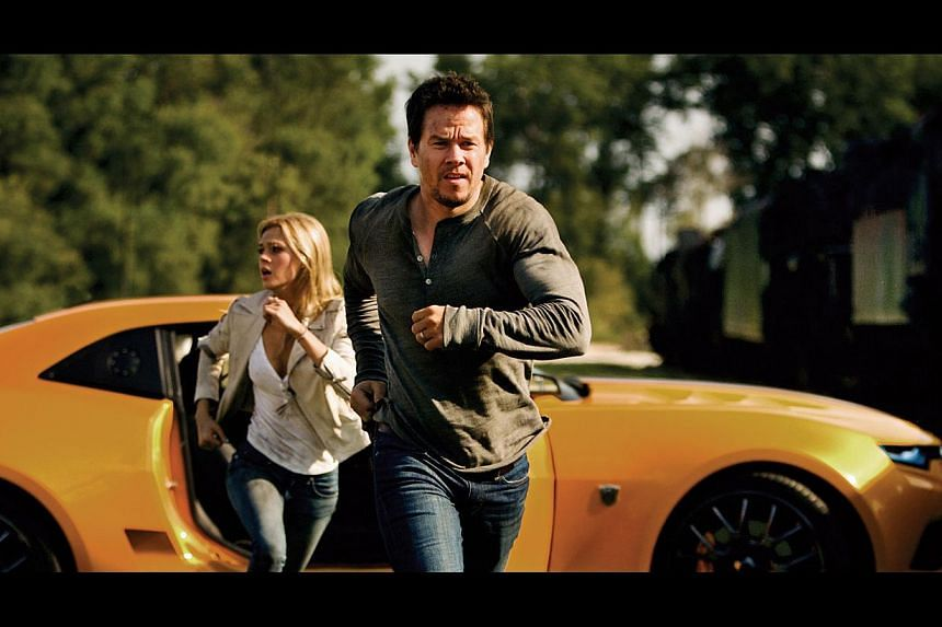 Mark Wahlberg and Nicola Peltz (both left) take over the starring roles in the latest Transformers movie.