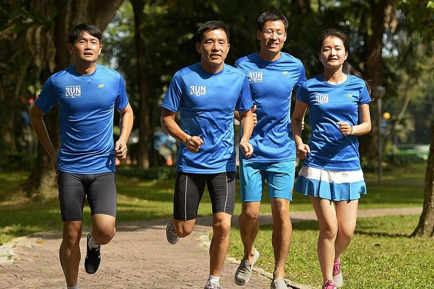 (From left) Mr Sun Yue, 34, Mr Sun Yong, 42, Mr Li Chao, 27, and Ms Lin Xiao Qing, 31, from construction firm Qingjian International. The company is sponsoring more than 100 employees' participation in the ST Run at the Hub to encourage staff to pay