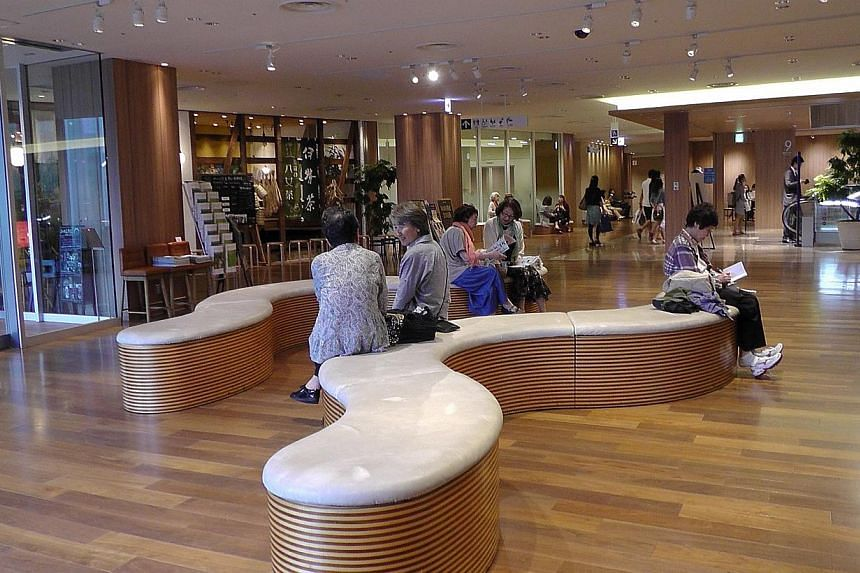 Shoppers taking a break on the ninth floor of the swanky Mitsukoshi department store in the shopping district of Ginza in Tokyo. Japan's department stores have been adapting to a rapidly graying population by providing more rest areas. -- ST P