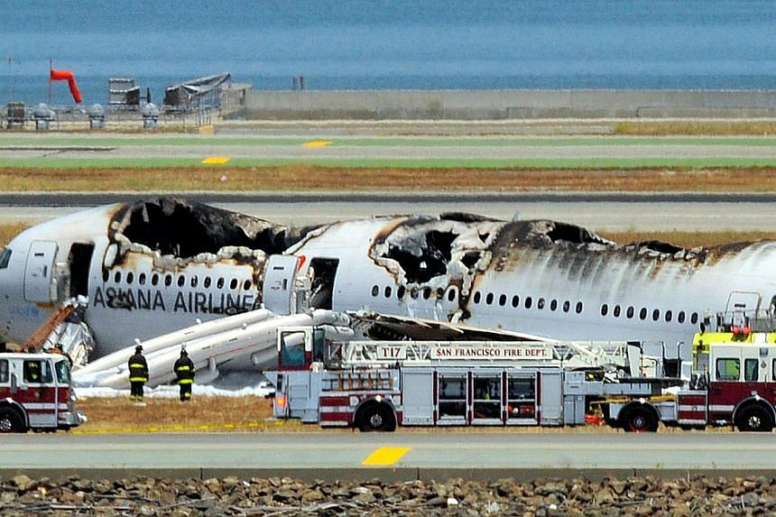 An Asiana Airlines Boeing 777 is seen on the runway at San Francisco International Airport after crash landing on July 6, 2013. -- PHOTO: AFP