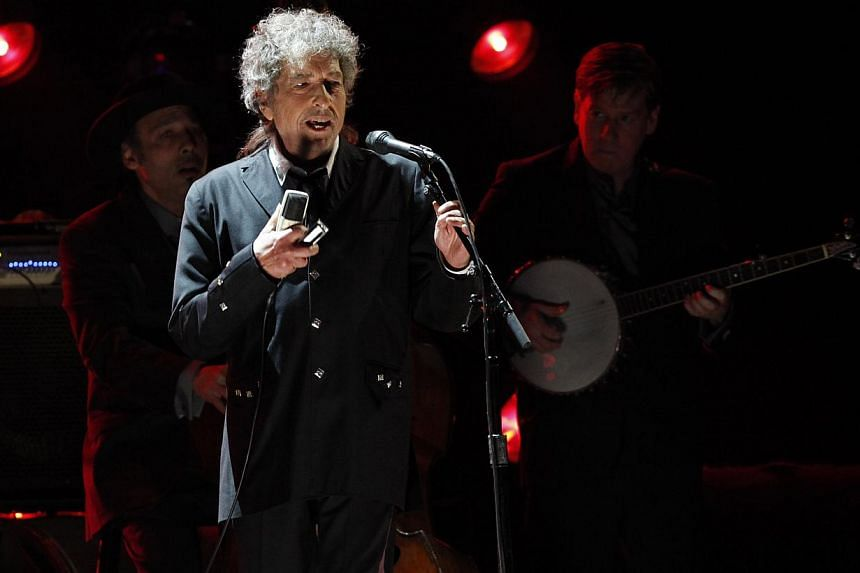 Singer Bob Dylan performs during a segment honouring Director Martin Scorsese, recipient of the Music+ Film Award, at the 17th Annual Critics' Choice Movie Awards in Los Angeles in this Jan 12, 2012, file photo. -- PHOTO: REUTERS