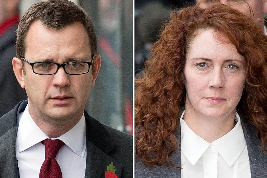 This file combination of pictures created on Oct 31, 2013 shows Former News of the World editor and Downing Street communications chief Andy Coulson (left) and Rebekah Brooks, former News International chief executive. -- PHOTO: AFP