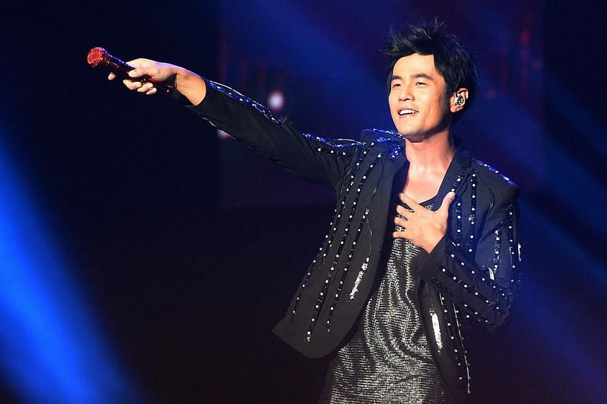 """Taiwanese singer Jay Chou performs at the SingTel Singapore Grand Prix Formula One Concert 2012 on Sept 21, 2012. Jay Chou announced that he would be """"a man of his word"""" and marry model Hannah Quinlivan before January next year. -- PHOTO: MYPAPER"""