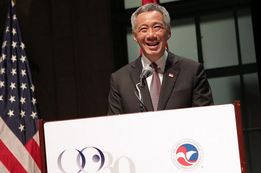 Singapore Prime Minister Lee Hsien Loong gives a speech during a reception to celebrate the 10th anniversary of US-Singapore FTA at the US Chamber of Commerce, in Washington DC, USA, on June 24, 2014. -- ST PHOTO: NEO XIAOBIN