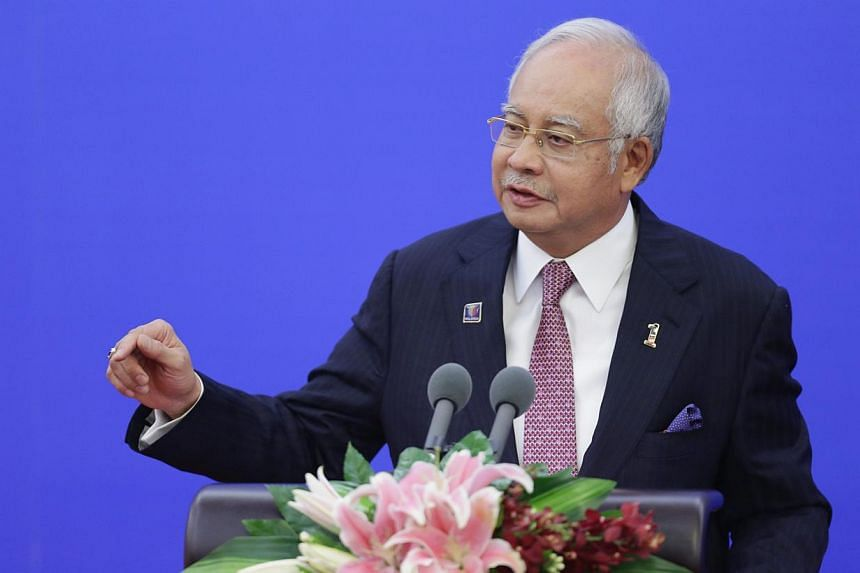 Malaysian Prime Minister Najib Razak has called a press conference on Wednesday and speculation is rife that it is related to a reshuffle of the Cabinet. -- PHOTO: REUTERS