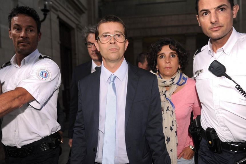 French former doctor at the Bayonne hospital Nicolas Bonnemaison arrives with his wife Julie at the courthouse of Pau, south-western France, on June 25, 2014, on the last day of his trial for allegedly poisoning seven terminally ill patients in 2010