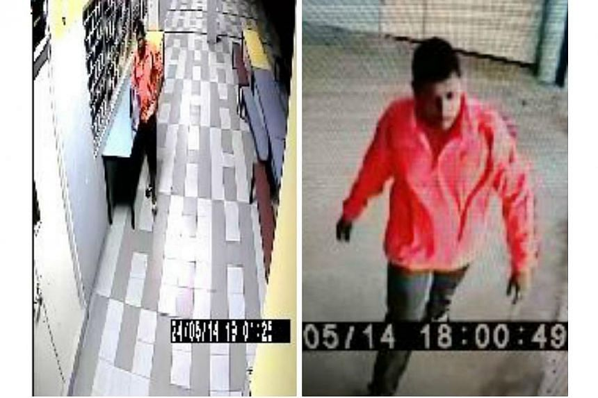 Police are looking for a man, pictured above, to assist with investigations into a case of housebreaking at Henderson Road on May 25.-- PHOTO: SINGAPORE POLICE FORCE