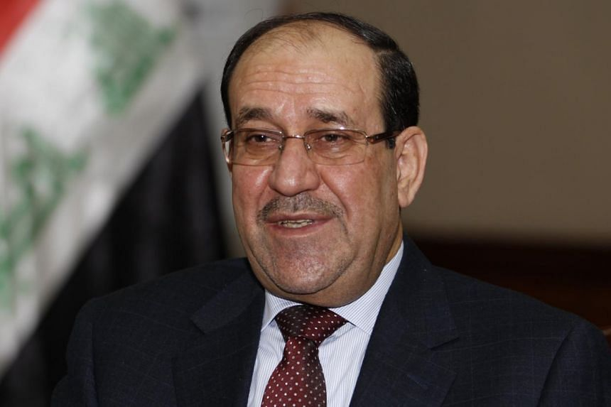 Iraq's Prime Minister Nouri al-Maliki speaks during an interview with Reuters in Baghdad in this Jan 12, 2014, file photo.Mr Maliki said on Wednesday he is committed to forming a new government on time as he fights growing calls from his oppone