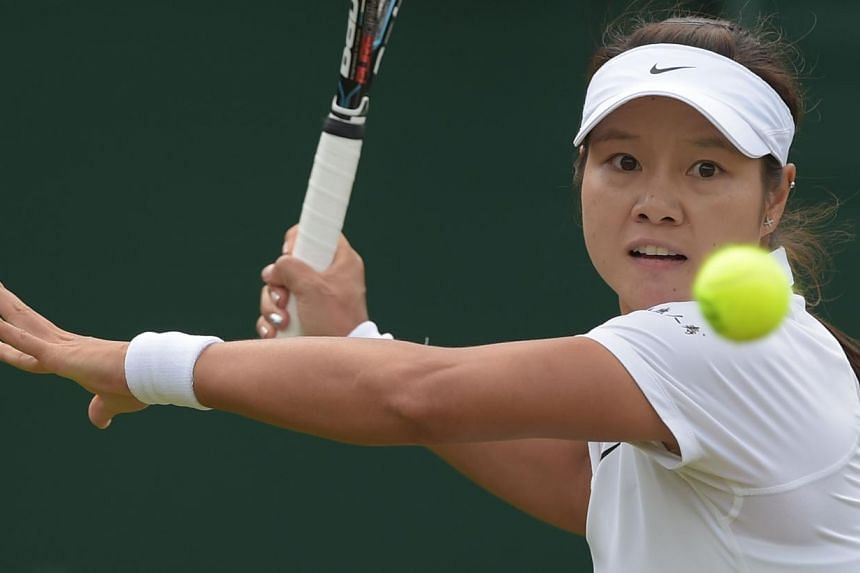 China's Li Na returns against Austria's Yvonne Meusburger during their women's singles second round match on day three of the 2014 Wimbledon Championships at The All England Tennis Club in Wimbledon, south-west London, on June 25, 2014. Li and five-t
