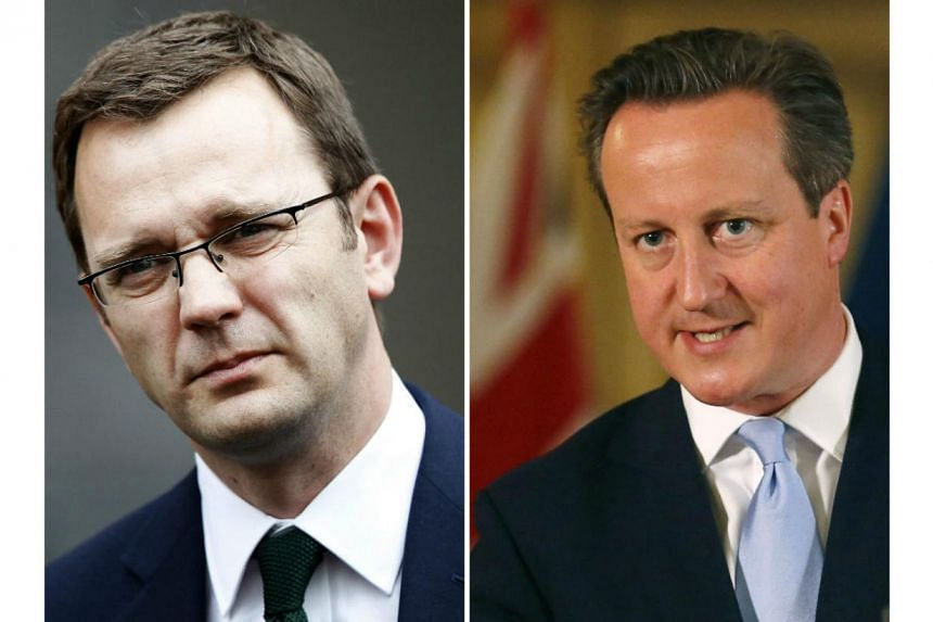 British Prime Minister David Cameron (right) on Wednesday apologised to parliament for hiring Andy Coulson, his ex-media chief, after Coulson was found guilty of being part of a phone-hacking conspiracy. -- PHOTO: REUTERS/AFP