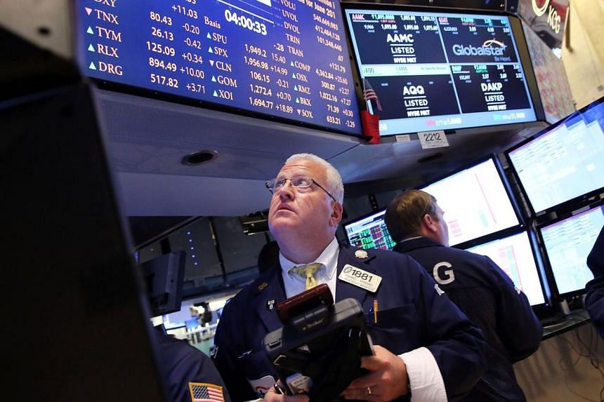 Traders work on the floor of the New York Stock Exchange (NYSE) on June 18, 2014, in New York City.The US economy contracted at a much steeper pace than previously estimated in the first quarter, but there are indications that growth has since