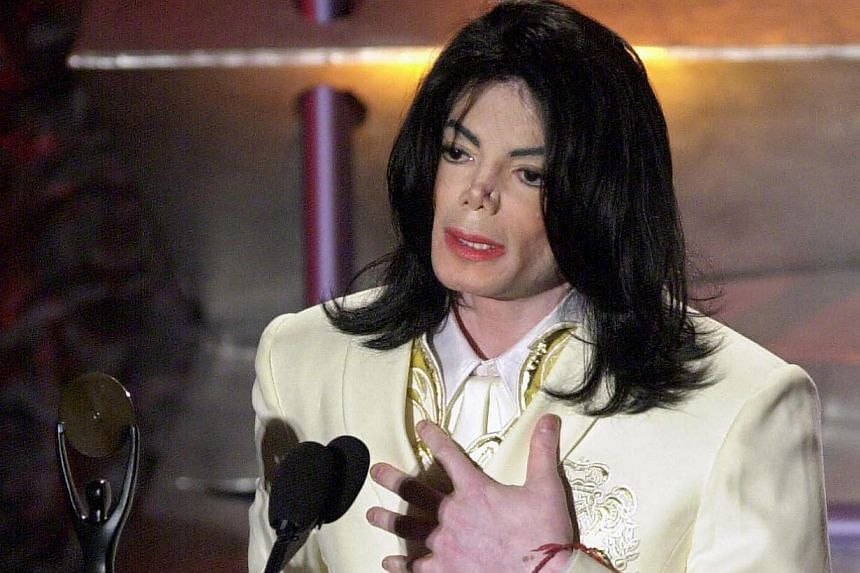 This March 19, 2001 file photo shows Michael Jackson accepting his induction into the Rock and Roll Hall of Fame in New York. -- PHOTO: AFP