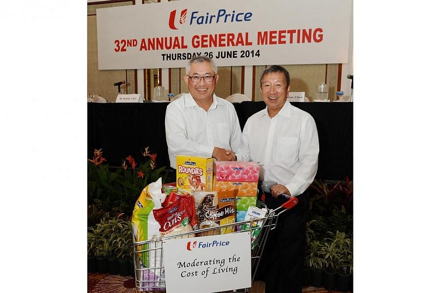 After almost nine years as chairman of NTUC FairPrice, Mr Ng Ser Miang (right) stepped down from his position on Thursday at the group's annual general meeting. Current board member Bobby Chin was subsequently elected as his successor.. -- PHOTO