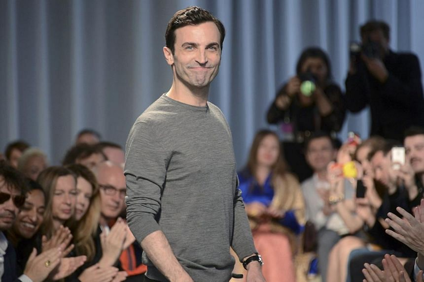 French designer Nicolas Ghesquiere appears at the end of the Louis Vuitton fashion show in Monaco, on May 17, 2014. Ghesquiere and the company that chose him at the age of 26 to inherit the Balenciaga throne will face each other across a Paris courtr