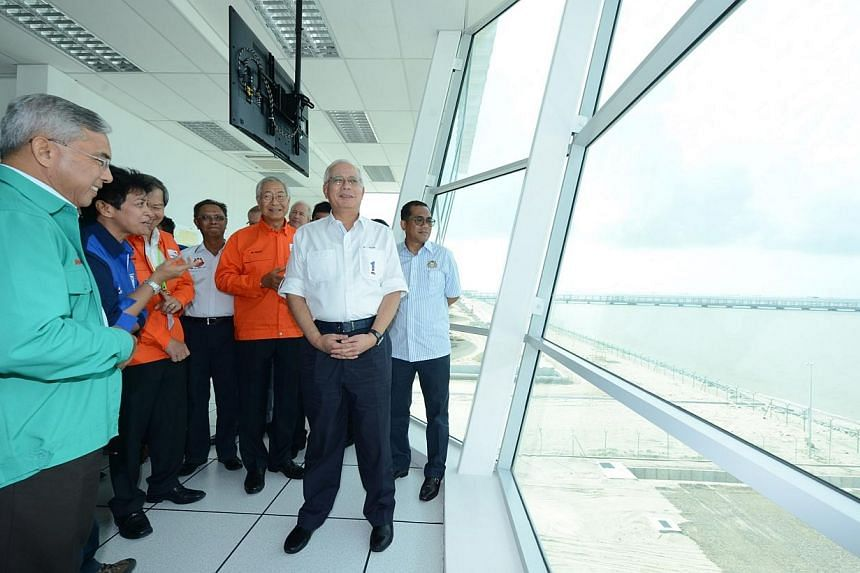 Malaysian prime minister Najib Razak looked out at the newly completed, 3km-long jetty for Pengerang Independent Terminals, an independent oil storage terminal built on 150 acres of reclaimed sea-bed land at the southern tip of Johor near Desaru. --