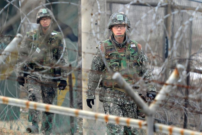 In a file photo taken on December 21, 2011 South Korean soldiers patrol at the Demilitarized Zone in Paju.The South Korean military refused on Thursday to release the suicide note of a soldier who killed five comrades, as speculation mounted th