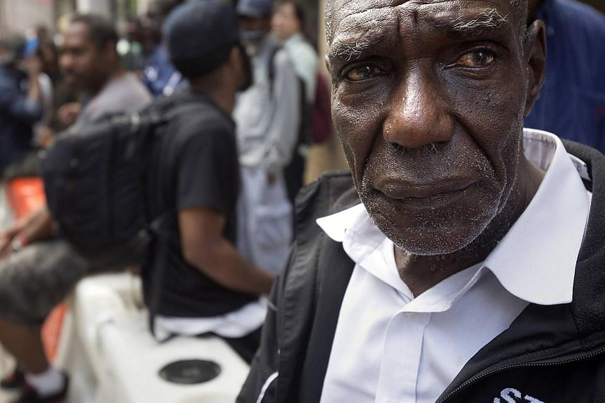 Leroy Brown reacts after finding out he will not be receiving money that had been promised him outside the New York Rescue Mission in the Manhattan borough of New York on June 25, 2014. -- PHOTO: REUTERS