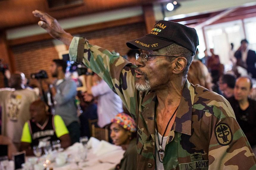 Mr Harry Brooks dances during a lunch and press conference held by Chen Guangbiao, a Chinese recycling magnate, who hosted the event for approximately 200 homeless people, at TheBoatHouse in Central Park, on June 25, 2014 in New York City. -- P