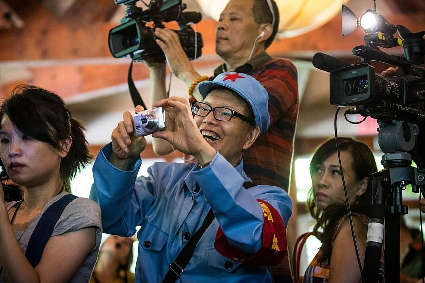 Members of the media and fans attend a lunch and press conference held by Chen Guangbiao, a Chinese recycling magnate, who hosted to event as a lunch for approximately 200 homeless people, at The BoatHouse in Central Park, on June 25, 2014 in New Yor