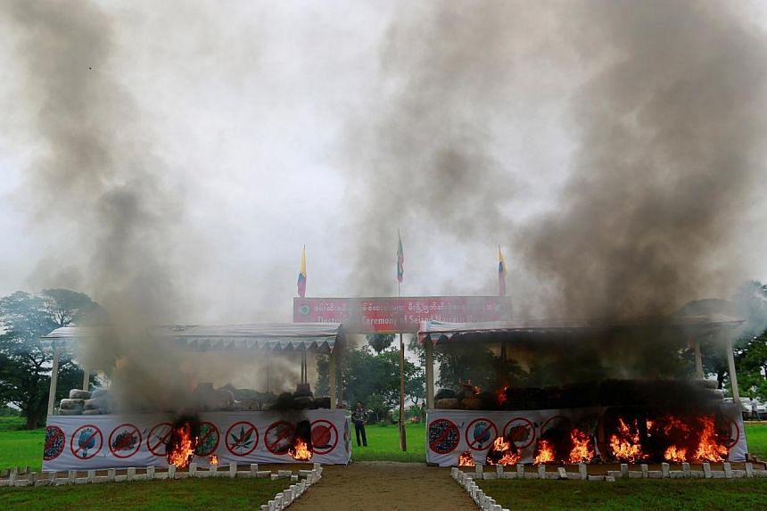 Smoke rises from the burning of seized drugs at an event to mark International Day against Drug Abuse and Illicit Trafficking outside Yangon June 26, 2014. The government destroyed $9.7 million worth of drugs in the event. -- PHOTO: AFP
