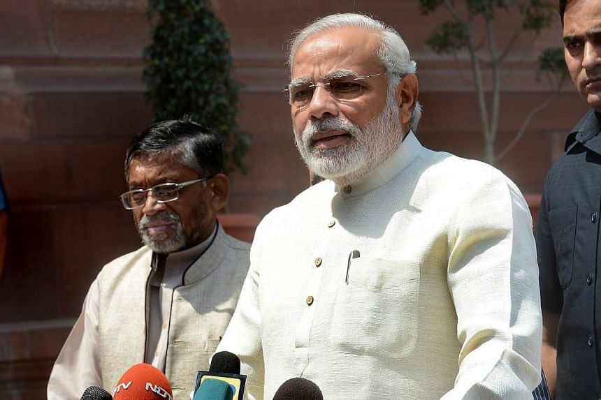 Indian Prime Minister Narendra Modi addresses the media on his arrival for the first session of India's newly elected Parliament in New Delhi on June 4, 2014. The Indian PMfaces accusations his government ran a campaign to block the appointment