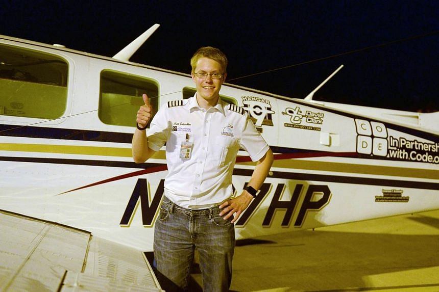 Pilot Matt Guthmiller, 19, poses in front of his single-engined Beechcraft A36 Bonanza aircraft following his arrival at the Dr Babasaheb Ambedkar International Airport in Nagpur early on June 26, 2014. -- PHOTO: AFP