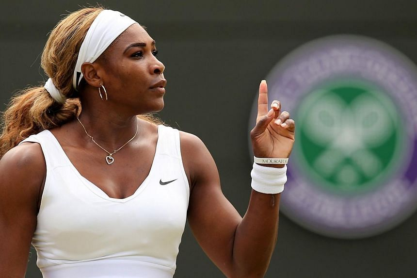 US player Serena Williams gestures during her women's singles second round match against Russia's Chanelle Scheepers on day four of the 2014 Wimbledon Championships at The All England Tennis Club in Wimbledon, south-west London, on June 26, 2014. --