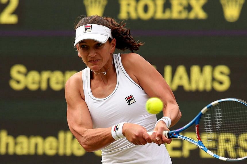 Russia's Chanelle Scheepers returns to US- player Serena Williams during their women's singles second round match on day four of the 2014 Wimbledon Championships at The All England Tennis Club in Wimbledon, south-west London, on June 26, 2014. -- PHO