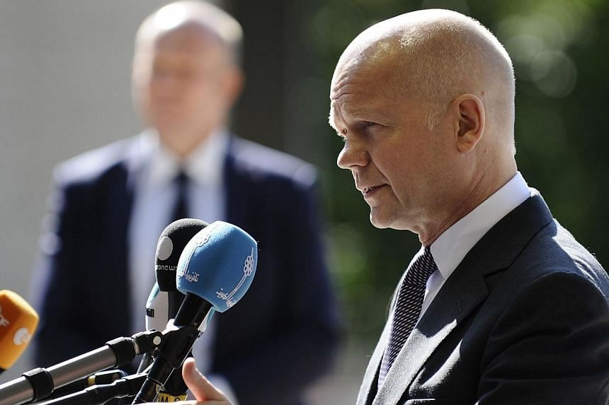 British Foreign Secretary of State for Foreign and Commonwealth Affairs, William Hague answers journalists before a Foreign Affairs Council meeting in Luxembourg on June 23, 2014.Mr Hague made a surprise visit to Baghdad on Thursday, June 26, 2