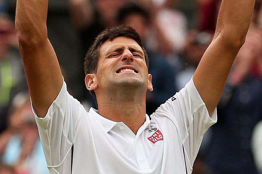 Serbia's Novak Djokovic celebrates after winning his men's singles second round match against Czech Republic's Radek Stepanek on day three of the 2014 Wimbledon Championships at The All England Tennis Club in Wimbledon, southwest London, on June 25,