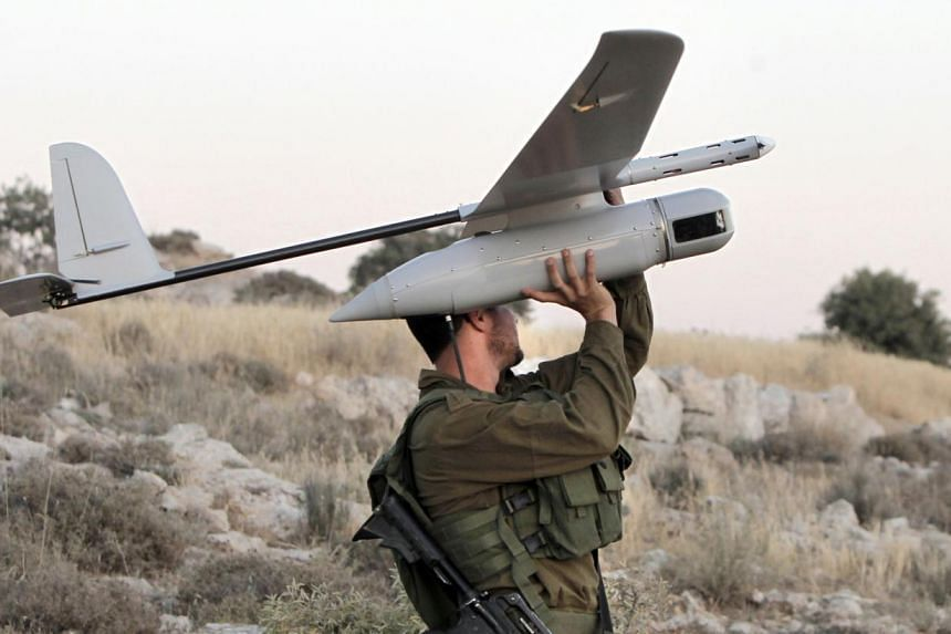 A drone being prepared by Israeli soldiers for use over the West Bank town of Hebron to search for three teenagers kidnapped earlier this month. Formertop US officials, in a report, have acknowledged that the robotic aircraft are a useful tool